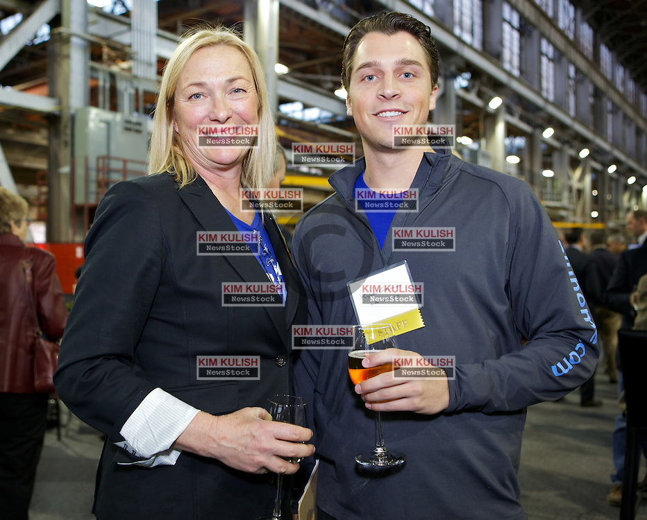 Ingrid Sywak and Kyle Gulock of Blu Homes were all smiles   as Blu Homes opens their West Coast factory on Mare Island in Vallejo, California Dec. 1, 2011.  Over 400 guests attended a ribbon cutting ceremony at the 250,000-square-foot facility.