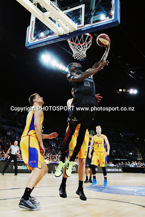 Ekene Ibekwe of the Breakers goes up for a shot. 2014/15 ANBL, SkyCity Breakers vs Adelaide 36ers, Vector Arena, Auckland, New Zealand. Thursday 12 February 2015. Photo: Anthony Au-Yeung / www.photosport.co.nz
