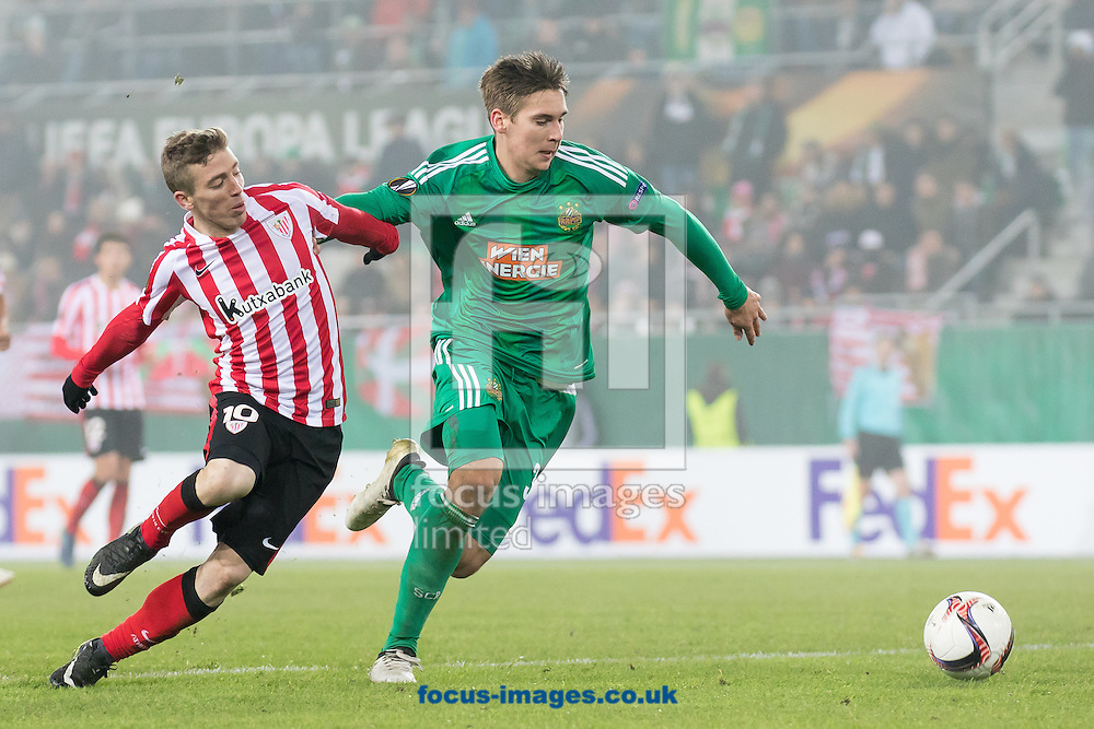Maximilian Woeber  of Rapid Vienna and Iker Muniain of Athletic Bilbao during the UEFA Europa League match at Allianz Stadion, Vienna<br /> Picture by EXPA Pictures/Focus Images Ltd 07814482222<br /> 08/12/2016<br /> *** UK &amp; IRELAND ONLY ***<br /> <br /> EXPA-PUC-161208-0196.jpg