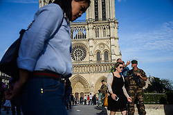 June 4, 2017 - Paris, France - Military guard the place around Notre Dame de Paris cathedrale. People used the first days of the summer for walking around the French capital of Paris. The temperature of the weather is about 25 celsius degrees Paris, France on June 04, 2017  (Credit Image: © Hristo Rusev/NurPhoto via ZUMA Press)