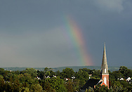 Middletown, NY  - A rainbow arcs across the sky behind the steeple of St. Joseph's Church on Aug. 2, 2008.