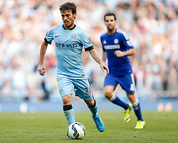 David Silva of Manchester City in action as Cesc Fabregas of Chelsea looks on - Photo mandatory by-line: Rogan Thomson/JMP - 07966 386802 - 21/08/2014 - SPORT - FOOTBALL - Manchester, England - Etihad Stadium - Manchester City v Chelsea FC - Barclays Premier League.