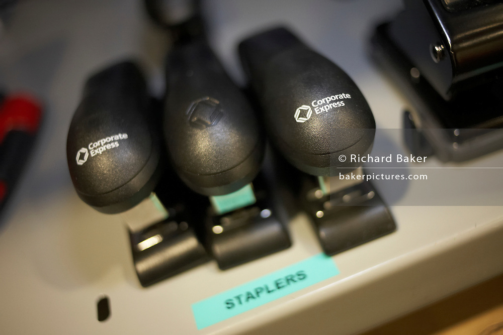 Staplers are available on a shelf in the stationery room of an auditing company at their London headquarters