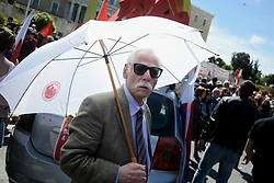 May 1, 2019 - Athens, Greece - An elderly protester seen holding an umbrella during the demonstration marking Mayday..Demonstrators are demanding better salary and worker's rights. (Credit Image: © Giorgos Zachos/SOPA Images via ZUMA Wire)