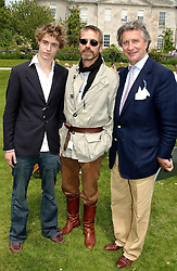 """Left to right, MR MAX IRONS, his father actor JEREMY IRONS and ARNAUD BAMBERGER at a luncheon hosted by Cartier at the 2004 Goodwood Festival of Speed on 27th June 2004.  Cartier sponsored the """"Style Et Luxe' for vintage cars on the final day of this annual event at Goodwood House, West Sussex."""