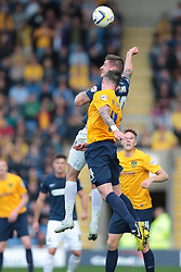 Southend United's Barry Corr and Oxford United's Michael Raynes go for the ball - Photo mandatory by-line: Nigel Pitts-Drake/JMP - Tel: Mobile: 07966 386802 05/10/2013 - SPORT - FOOTBALL - Kassam Stadium - Oxford - Oxford United v Southend United - Sky Bet League 2