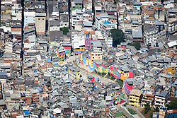 Moradias coloridas construidas pelo PAC, em projeto de revitalizacao da Rua 4,na favela da Rocinha, uma das maiores favelas da cidade do Rio de Janeiro./ Colorful houses built by the PAC in revitalization project of 4th Street, in the slum of Rocinha, one of the biggest slum in the city of Rio de Janeiro. RJ, Brasil - 2011