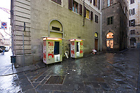 Two photo booths on the side of the street in Florence Italy