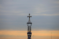 The instantly recognisable cross atop the entrance building to Park Guell in Barcelona, Spain.