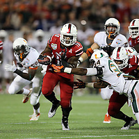 Louisville Cardinals running back Dominique Brown (10) is seen during the NCAA Football Russell Athletic Bowl football game between the Louisville Cardinals and the Miami Hurricanes, at the Florida Citrus Bowl on Saturday, December 28, 2013 in Orlando, Florida. (AP Photo/Alex Menendez)