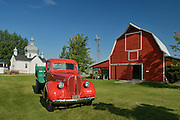 Old truck and barn at Fort la Reine Museum<br /> Portage La Prairie<br /> Manitoba<br /> Canada