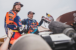 Matthias Walkner (AUT) and Toby Price (AUS) of Red Bull KTM Factory Team at the finish line after he wins the Rally Dakar 2019, Peru on January 17, 2019. // Flavien Duhamel/Red Bull Content Pool // AP-1Y5HCFZYW2111 // Usage for editorial use only // Please go to www.redbullcontentpool.com for further information. //