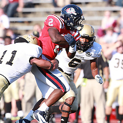 Samford running back Fabian Truss is hit by Wofford James Zotto  at Seibert Stadium in Homewood, Ala., Saturday, Oct 13, 2012. Samford defeats Wofford 24-17 in Overtime. (Marvin Gentry)