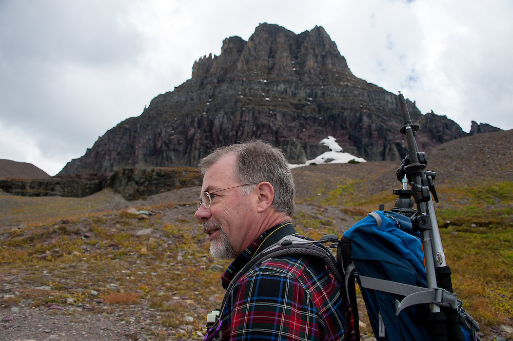 Research ecologist, Daniel Fagre Ph.D., on Hidden Lake Trail heading towards Mount Clements at Logan Pass in Glacier National Park, Montana, Tuesday, October 7, 2014. Fagre and his staff are working on the climate change in mountain ecosystems project which includes looking at what has happened in Glacier National Park since the little ice age ended in 1850.
