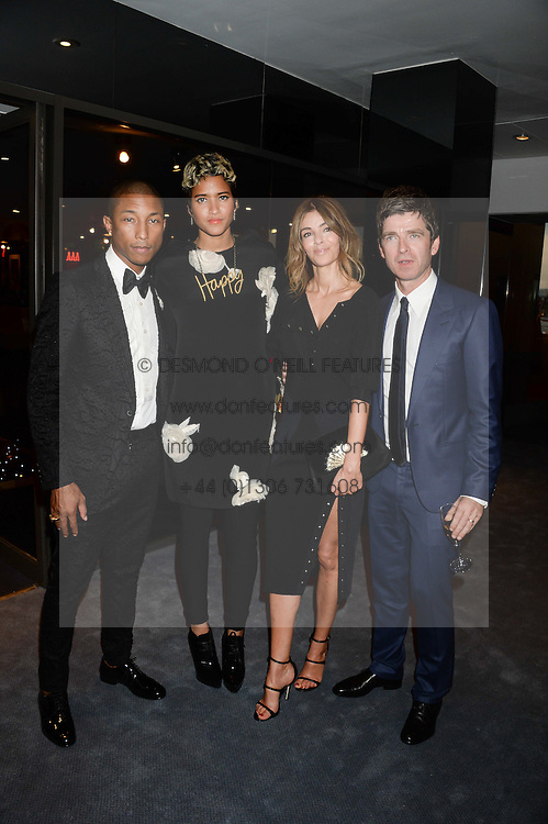 Left to right, PHARRELL WILLIAMS, HELEN LASICHANH, SARAH McDONALD and NOEL GALLAGHER at the GQ Men of The Year Awards 2013 in association with Hugo Boss held at the Royal Opera House, London on 3rd September 2013.