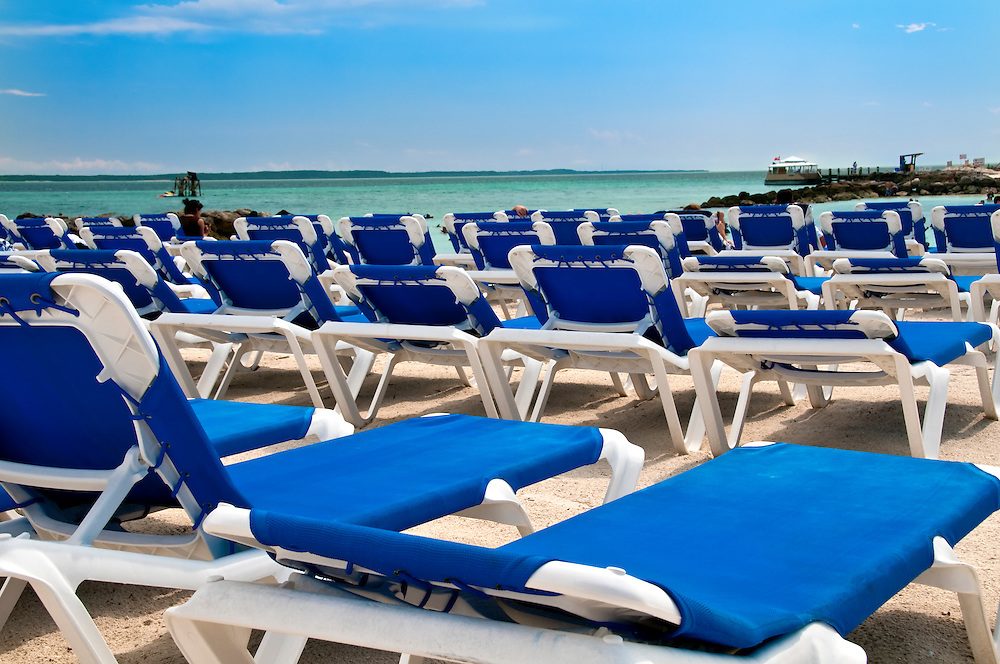 View of Chairs at beach in the Bahamas in the Caribbean.