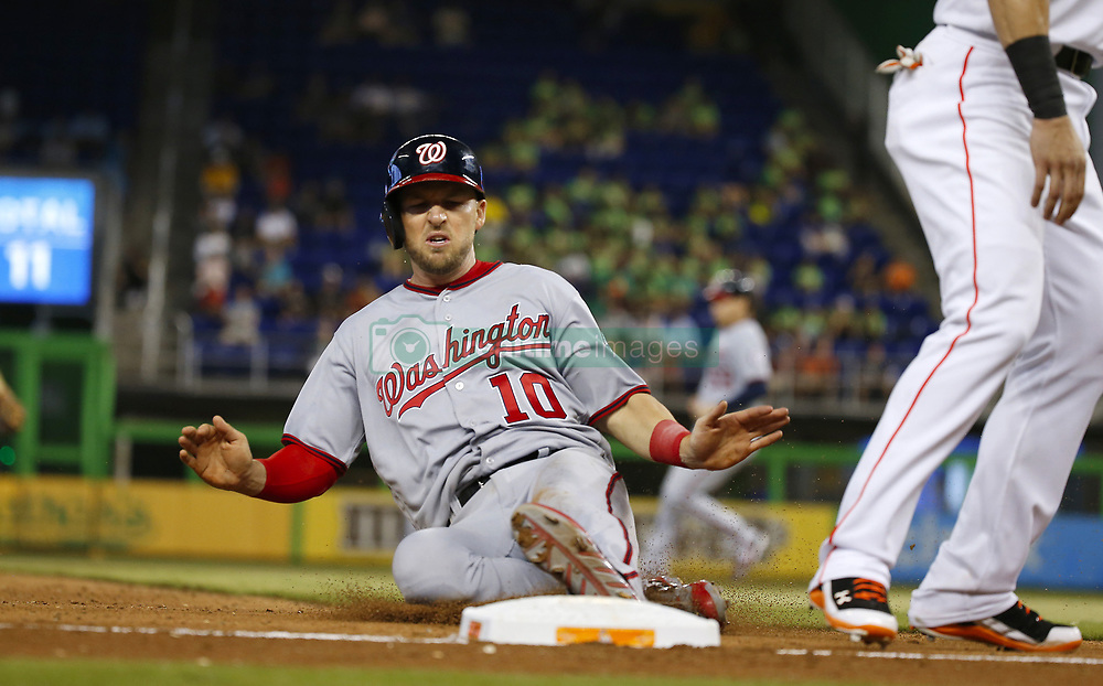 June 21, 2017 - Miami, FL, USA - Washington Nationals second baseman Stephen Drew slides safely into third base during the eighth inning against the Miami Marlins on Wednesday, June 21, 2017 at Marlins Park in Miami, Fla. (Credit Image: © David Santiago/TNS via ZUMA Wire)