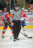 KELOWNA, CANADA - OCTOBER 10:  Referee Nick Swaine gets ready to drop the puck as the Spokane Chiefs visit the Kelowna Rockets on October 10, 2012 at Prospera Place in Kelowna, British Columbia, Canada (Photo by Marissa Baecker/Shoot the Breeze) *** Local Caption ***
