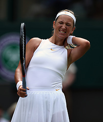Victoria Azarenka holds her neck on day three of the Wimbledon Championships at the All England Lawn Tennis and Croquet Club, Wimbledon.