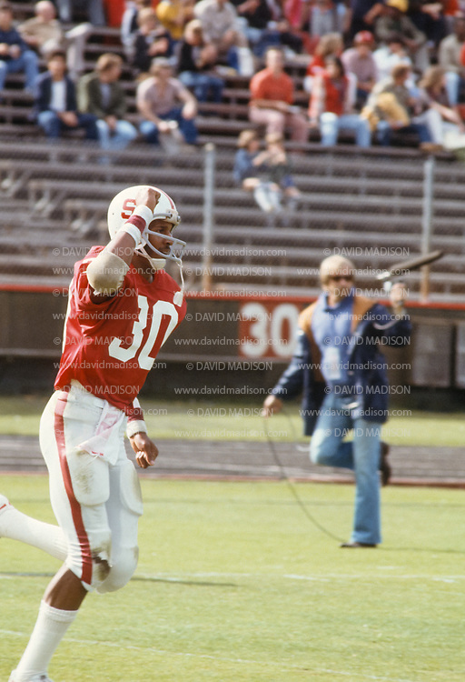 PALO ALTO, CA -  NOVEMBER 12:  Wide receiver James Lofton #30 of Stanford University celebrates after making a catch during an NCAA football game against the San Jose State Spartans played November 12, 1977 at Stanford Stadium on the campus of Stanford University in Palo Alto, California.  Lofton later played in the NFL and is a member of the Pro Football Hall of Fame. (Photo by David Madison/Getty Images) *** Local Caption *** James Lofton