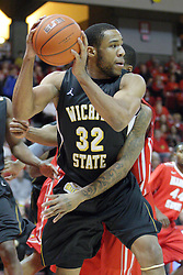 17 February 2013:  Tekele Cotton gets armed by Tyler Brown during an NCAA Missouri Valley Conference mens basketball game where the Shockers of Wichita State played the Illinois State Redbirds  in Redbird Arena, Normal IL
