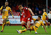 Darnell Furlong of Cambridge United gets a vital tackle in on Matt Harrold of Crawley Town during the Sky Bet League 2 match between Crawley Town and Cambridge United at the Checkatrade.com Stadium, Crawley, England on 9 January 2016. Photo by Andy Walter.