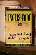 "Tin of ""INGLIS FOOD: Nourishing, Bland and easily digested."" The Skye Museum of Island Life preserves a township of thatched cottages as they would have been in the late 1800s on the Isle of Skye, in Kilmuir village, the Trotternish peninsula, Scotland, United Kingdom, Europe. Skye is the largest and northernmost of the major islands in the Inner Hebrides."