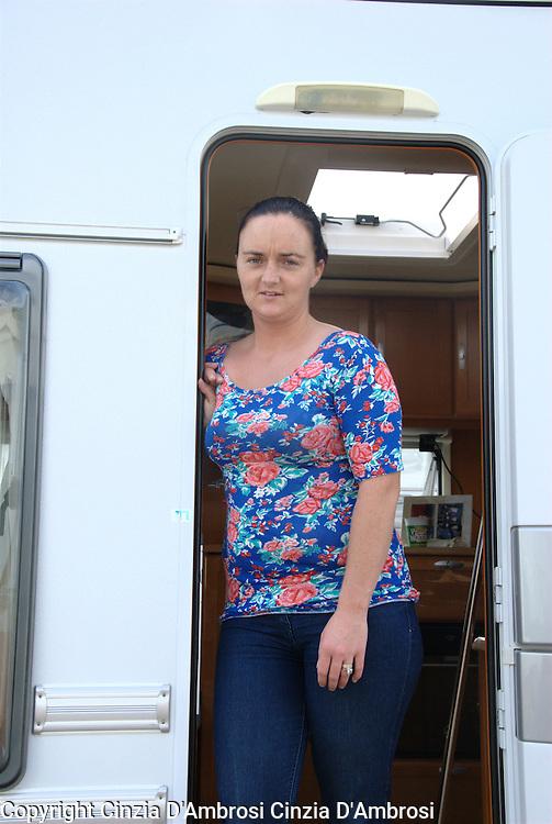 Jean outside her caravan home at Dale Farm site