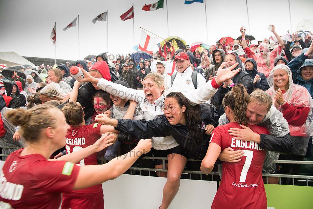 England fans and players celebrate at the end og the 3/4 place game at the 2017 FIL Rathbones Women's Lacrosse World Cup at Surrey Sports Park, Guilford, Surrey, UK, 15th July 2017