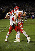 Kansas City Chiefs tight end Anthony Fasano (80) fist bumps with Chiefs fullback Anthony Sherman (42) as they celebrate after Fasano catches a 19 yard touchdown pass that cuts the Oakland Raiders third quarter lead to 17-10 during the NFL week 12 regular season football game against the Oakland Raiders on Thursday, Nov. 20, 2014 in Oakland, Calif. The Raiders won their first game of the season 24-20. ©Paul Anthony Spinelli