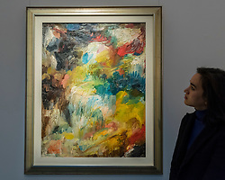 "© Licensed to London News Pictures. 25/11/2016. London, UK. A staff member views ""Composition"" by Vladmir Nemukhin, (est. GBP 12-18k), from the Bar-Gera Collection, at the preview of artworks from Sotheby's upcoming Russian sales in New Bond Street, where over three hundred works spanning several centuries will be offered. Photo credit : Stephen Chung/LNP"