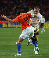 Photo: Paul Thomas.<br /> Holland v England. International Friendly. 15/11/2006.<br /> <br /> Wayne Rooney of England (R) battles with Joris Mathijsen (4).