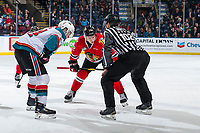 KELOWNA, CANADA - MARCH 2: Kyle Topping #24 of the Kelowna Rockets faces off against Reece Newkirk #12 of the Portland Winterhawks  on March 2, 2019 at Prospera Place in Kelowna, British Columbia, Canada.  (Photo by Marissa Baecker/Shoot the Breeze)