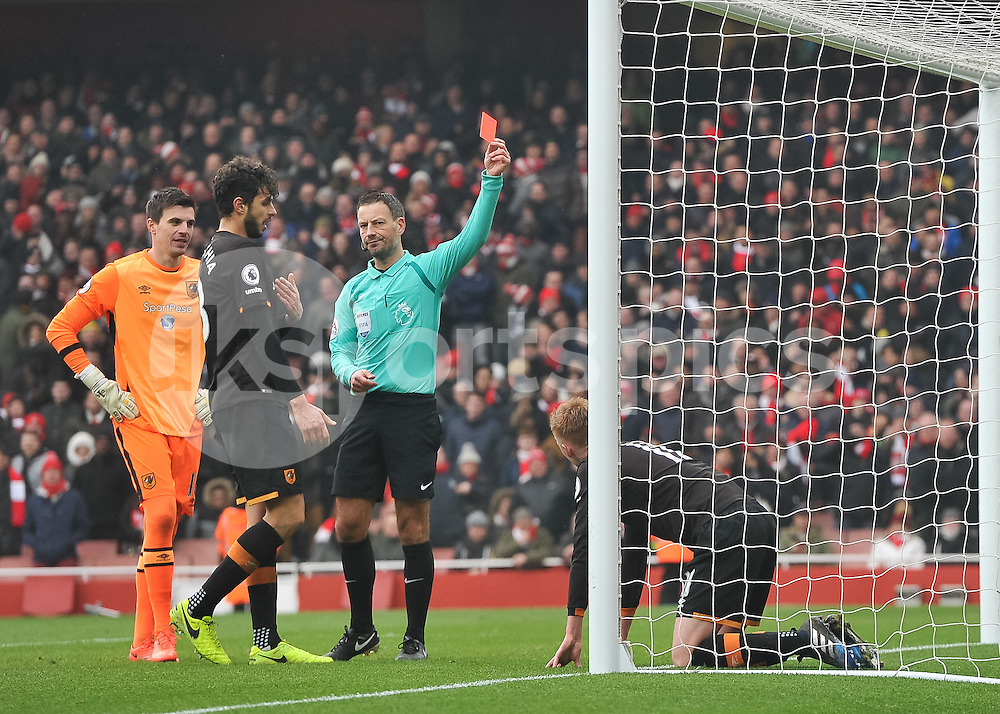 Referee Mark Clattenburg shows Sam Clucas of Hull City the red card during the Premier League match between Arsenal and Hull City at the Emirates Stadium, London, England on 11 February 2017. Photo by Vince  Mignott.