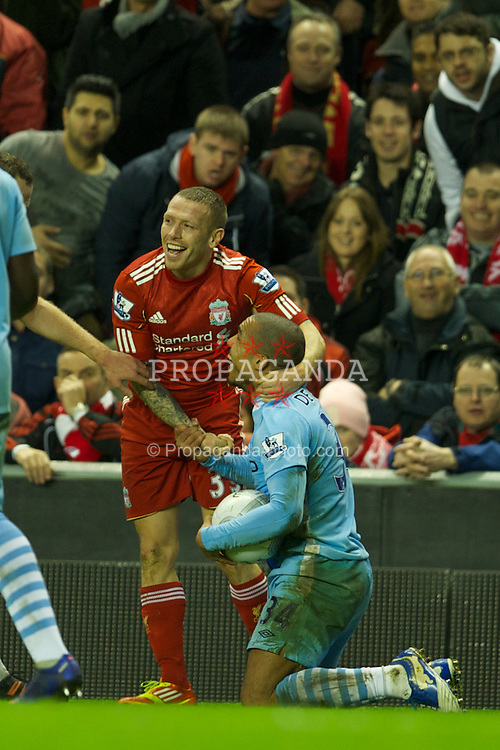 LIVERPOOL, ENGLAND - Wednesday, January 25, 2012: Liverpool's Craig Bellamy in action against Manchester City's Nigel de Jong during the Football League Cup Semi-Final 2nd Leg at Anfield. (Pic by David Rawcliffe/Propaganda)