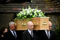 © Licensed to London News Pictures. 18/04/2016. Shirley, UK.  The coffin leaving the church following the funeral of comedian, actor, writer Ronnie Corbett at St John the Evangelist Church in Shirley near Croydon. Corbett, who was most famous for his comedy sketch show  The Two Ronnies, performed with the late Ronnie Barker, died at the age of 85. Photo credit: Ben Cawthra/LNP