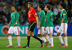 Giovani Dos Santos, Efrain Juarez, Gerardo Torrado and Rafael Marquez of Mexico complain after first goal of Argentina to referee Roberto Rosetti during the 2010 FIFA World Cup South Africa Round of Sixteen match between Argentina and Mexico at Soccer City Stadium on June 27, 2010 in Johannesburg, South Africa. Argentina defeated Mexico 3-1 and qualified for quarterfinals. (Photo by Vid Ponikvar / Sportida)