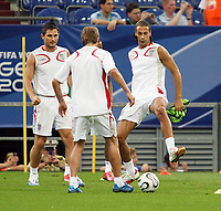 Photo: Chris Ratcliffe.<br />England Training Session. FIFA World Cup 2006. 30/06/2006.<br />David Beckham, Frank Lampard and Rio Ferdinand in training.