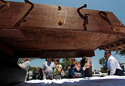 May 7, 2011 - Tampa, FL, USA - TP_338258_CERR_BEAM (05/07/11, Tampa) Ryan Gussman, 8, of Tampa, reaches out to touch a steel beam from the World Trade Center with the help of his father, Tony Gussman. Tony and Barbara Gussman brought their son to see the piece of the World Trade Center that was donated to the Hillsborough County Sheriff's Office and on display at Westfield Citrus Park Mall Saturday. ''He wasn't born when this happened,'' said Barbara. ''They haven't talked about it in school.'' Tony said that his son was ''touching a piece of history.'' The Port Authority of New York and New Jersey donated the 13-foot-long steel beam, which weighs 1,471 pounds, as a 9/11 memorial, said Larry McKinnon, a Sheriff's Office spokesman. Two deputies recently traveled to New York to bring the beam to Tampa. It is one of about 1,200 pieces of steel from the twin towers that was donated to law enforcement agencies and fire departments around the country. The beam will be displayed from 10 a.m. to 6 p.m. Sunday at Westfield Brandon Mall.    [LARA CERRI, Times] (Credit Image: © Lara Cerri/Tampa Bay Times/ZUMAPRESS.com)