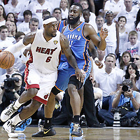 21 June 2012: Miami Heat small forward LeBron James (6) drives past Oklahoma City Thunder guard James Harden (13) during the second quarter of Game 5 of the 2012 NBA Finals, at the AmericanAirlinesArena, Miami, Florida, USA.