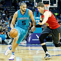 01 November 2015: Charlotte Hornets forward Nicolas Batum (5) drives past Atlanta Hawks guard Kyle Korver (26) during the Atlanta Hawks 94-92 victory over the Charlotte Hornets, at the Time Warner Cable Arena, in Charlotte, North Carolina, USA.