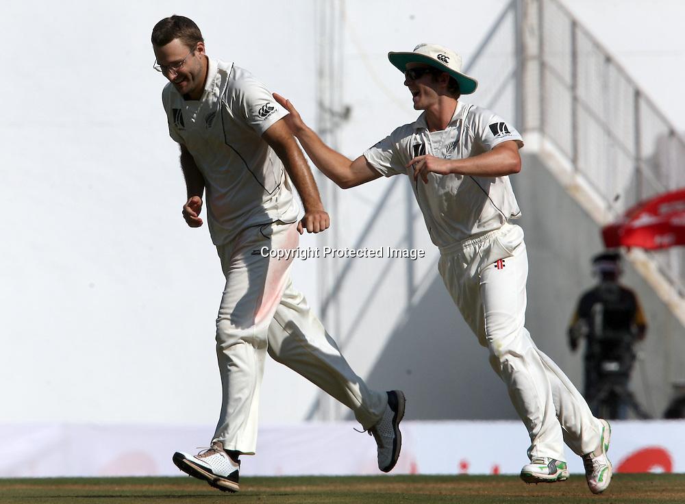 New Zealand bowler Daniel Vettori celebrates with kane Williamson Indian batsman Suresh Raina wicket during the 3rd test match India vs New Zealand day-3 Played at Vidarbha Cricket Association Stadium, Jamtha, Nagpur, 22, November 2010 (5-day match)