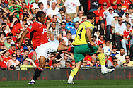 Picture by Paul Chesterton/Focus Images Ltd.  07904 640267.1/10/11.Wes Hoolahan of Norwich and Anderson of Man Utd in action during the Barclays Premier League match at Old Trafford Stadium, Manchester.