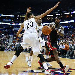 Mar 22, 2014; New Orleans, LA, USA; Miami Heat forward LeBron James (6) passes as New Orleans Pelicans forward Anthony Davis (23) and forward Al-Farouq Aminu (0) during the third quarter of a game at the Smoothie King Center. The Pelicans defeated the Heat 105-95. Mandatory Credit: Derick E. Hingle-USA TODAY Sports