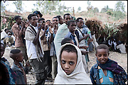 """Turunesh (middle, with white scarf), 8 years old, is being married, with a young guy, 10 years larger. Child marriage is a social phenomena in which the practice is that of marrying a young child to an adult. In practice this is almost always a young girl being married to a man. In a forced marriage, the parents choose their son's or daughter's future spouse with no input from the son or daughter. Motivating factors for such a marriage tend to be social or economic. In Ethiopia survives the practice of forced child marriage, even though is forbidden by the law, quite often ignored. North West of Ethiopia, on monday, Febrary 16 2009.....In a tangled mingling of tradition and culture, in the normal place of living, in a laid-back attitude. The background of Ethiopia's """"child brides"""", a country which has the distinction of having highest percentage in the practice of early marriages despite having a law that establishes 18 years as minimum age to get married. Celebrations that last days, their minds clouded by girls cups of tella and the unknown for the future. White bridal veil frame their faces expressive of small defenseless creatures, who at the age ranging from three to twelve years shall be given to young brides men adults already...To protect the identities of the recorded subjects names and specific places are fictional."""