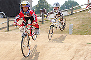 Miles Mozejko (385), 5 of Louisville, Kentucky and Tristan Von Rissen (172), 3 of Cincinnati during the American Bicycle Association Kettering BMX single races at Delco Park in Kettering, July 1, 2012.