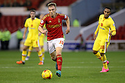 Nottingham Forest midfielder Ben Osborn heads for goal during the Sky Bet Championship match between Nottingham Forest and Milton Keynes Dons at the City Ground, Nottingham, England on 19 December 2015. Photo by Aaron Lupton.