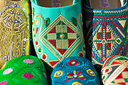 Decorative Moroccan slippers on sale in the souqs, Tetouan medina, Rif region of Northern Morocco, 2016-04-06.