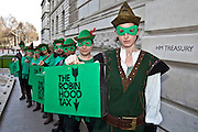 On Tuesday the 23rd of March 2010, the day before Alistair Darling makes his 2010 Budget speech, around a dozen Robin Hoods will be delivering their own green-coloured Budget boxes to the Treasury, calling on the Chancellor to announce the introduction of a tax on banks' financial transactions.. .To illustrate the call from the Robin Hood Tax campaign, the green-clad Robin Hoods will be marching in a line from College Green across Parliament Square en route to the Treasury offices in Parliament Street.. .Inside the green Robin Hood Tax campaign Budget boxes will be a letter to the Chancellor calling on him to kick start international agreement for new financial transaction taxes by using Wednesday's Budget to announce a new unilateral UK sterling tax.. .The boxes will also contain a scroll reminding Alistair Darling of the support that the Robin Hood Tax campaign has gathered since it launched last month. Some 100 organisations are now backing the coalition, which has 141,085 fans on Facebook and 71,492 people have voted yes to a financial transactions tax on the campaign's website www.robinhoodtax.org.uk
