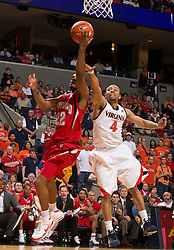 Maryland guard Adrian Bowie (22) shoots past Virginia guard Calvin Baker (4).  The Virginia Cavaliers defeated the Maryland Terrapins 68-63 at the John Paul Jones Arena on the Grounds of the University of Virginia in Charlottesville, VA on March 7, 2009.